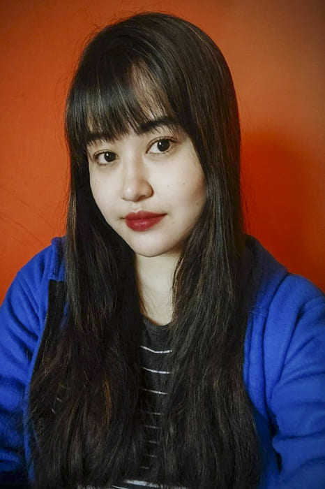Asian women long straight hairstyles with bangs