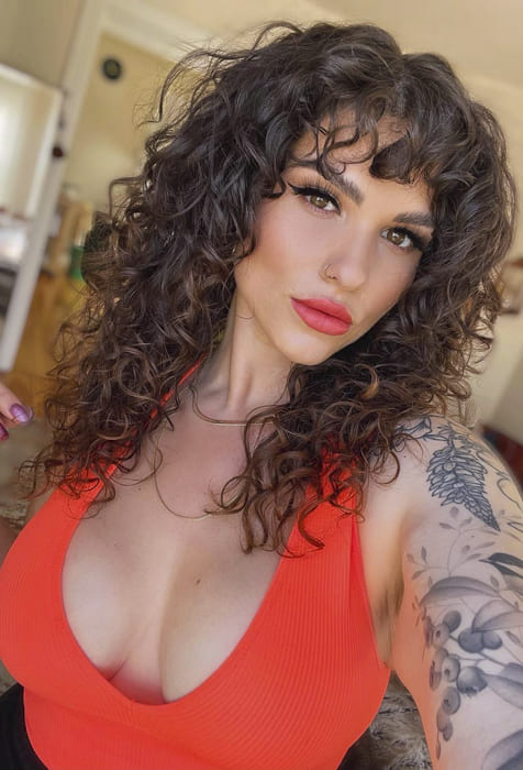Black long curly hairstyles with bangs