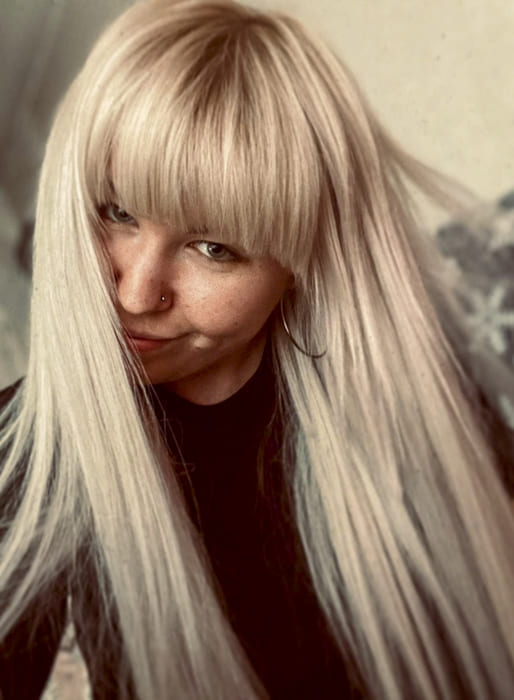 Platinum blonde long straight hairstyles with bangs