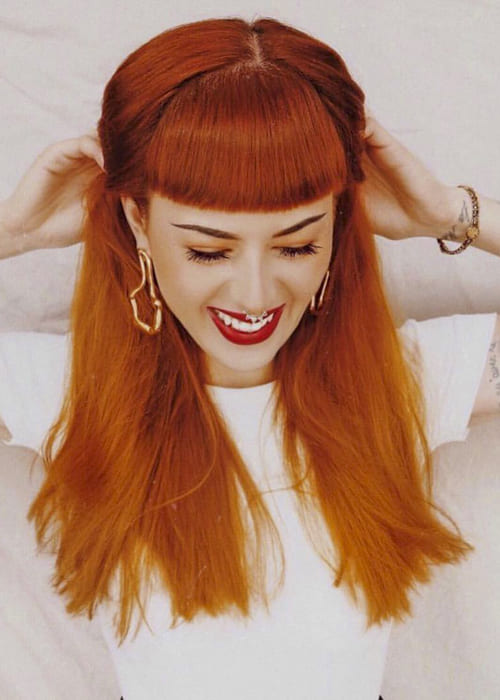 Red long straight hairstyles with bangs