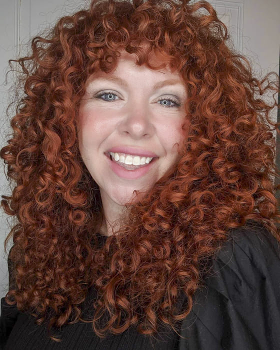 awesome red long curly hairstyles with bangs