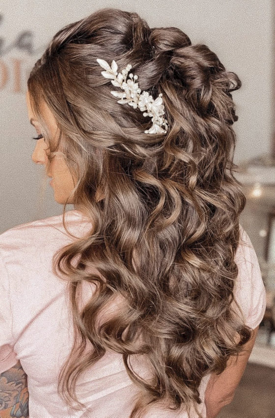 Curly and voluminous half up half down wedding hairstyles