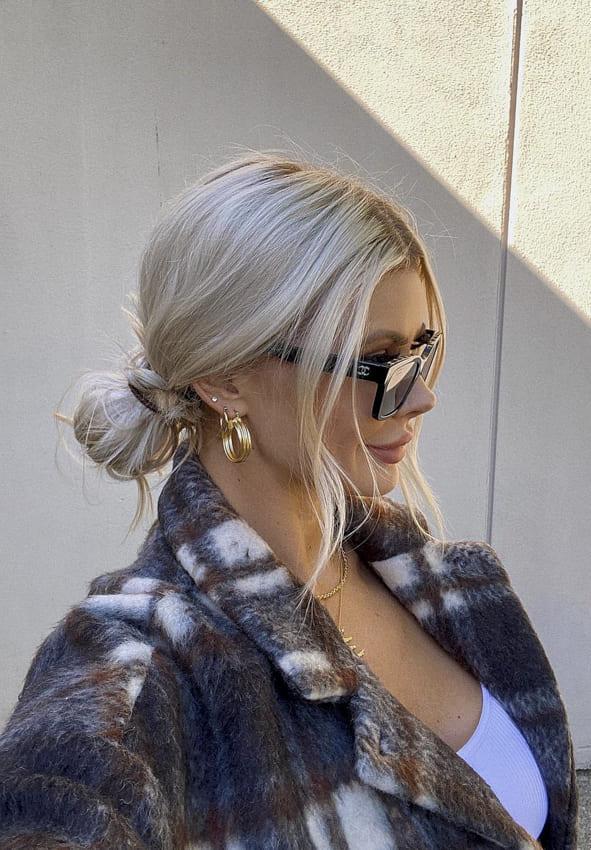 Long bun blonde hairstyles with side bangs