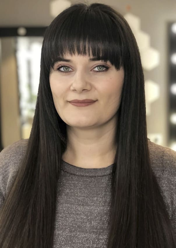 Long straight black hairstyles with bangs