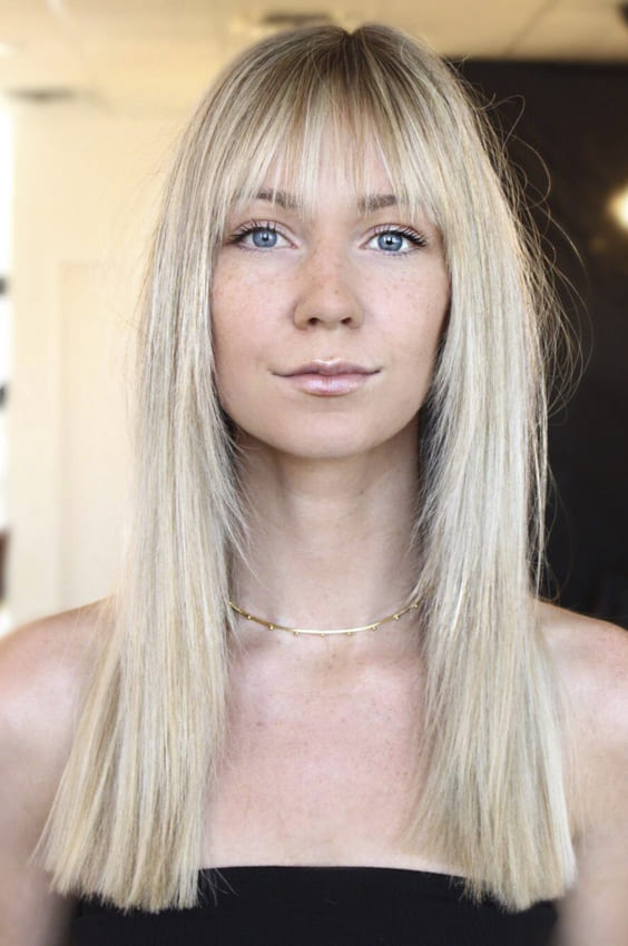 Long straight blonde hairstyles with bangs