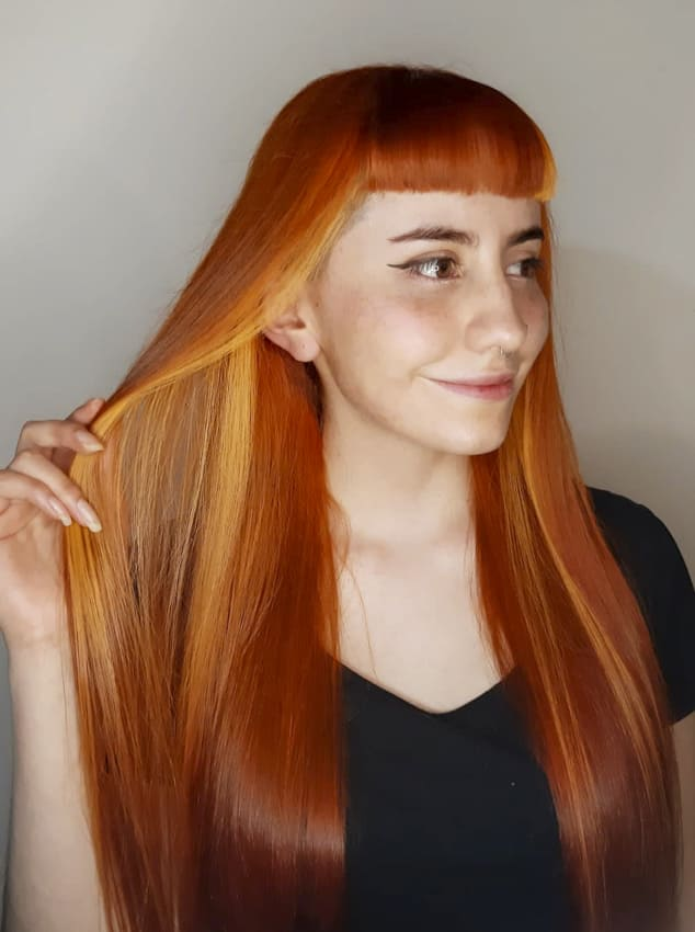 Long straight red hairstyles with bangs
