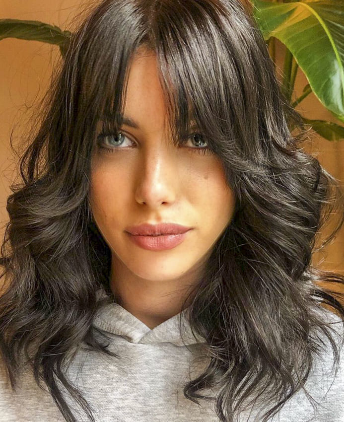 Medium layered hairstyles with side bangs