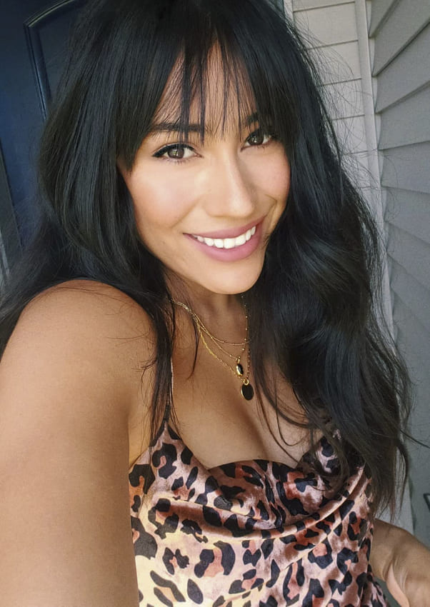 Wavy black long hairstyles with bangs