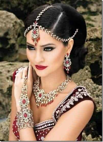 Indian wedding hairstyles updo hair and red dresses