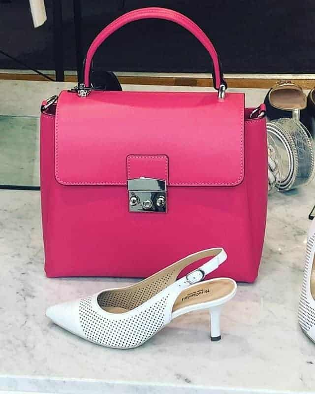Dark pink small handbag and white shoes