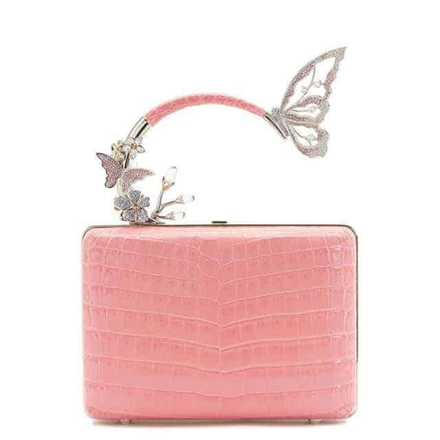 Elegantly designed pink handbag with butterfly