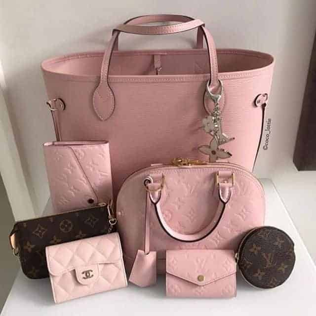 Pink colored handbag Wallet and bag set