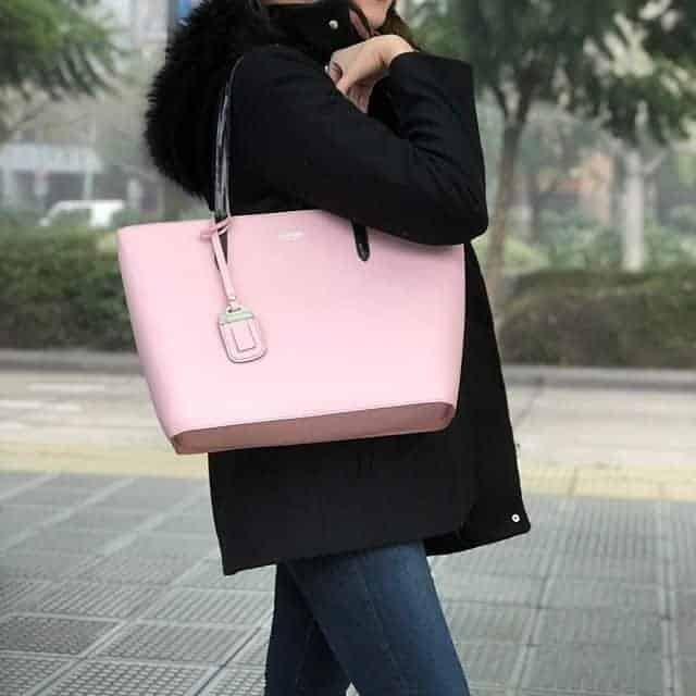 Great big pink bag hanging on the shoulder