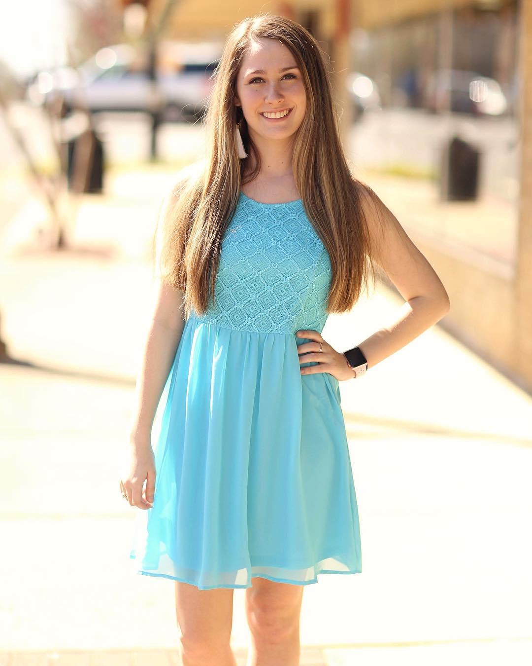 Turquoise dress for wedding invitation.