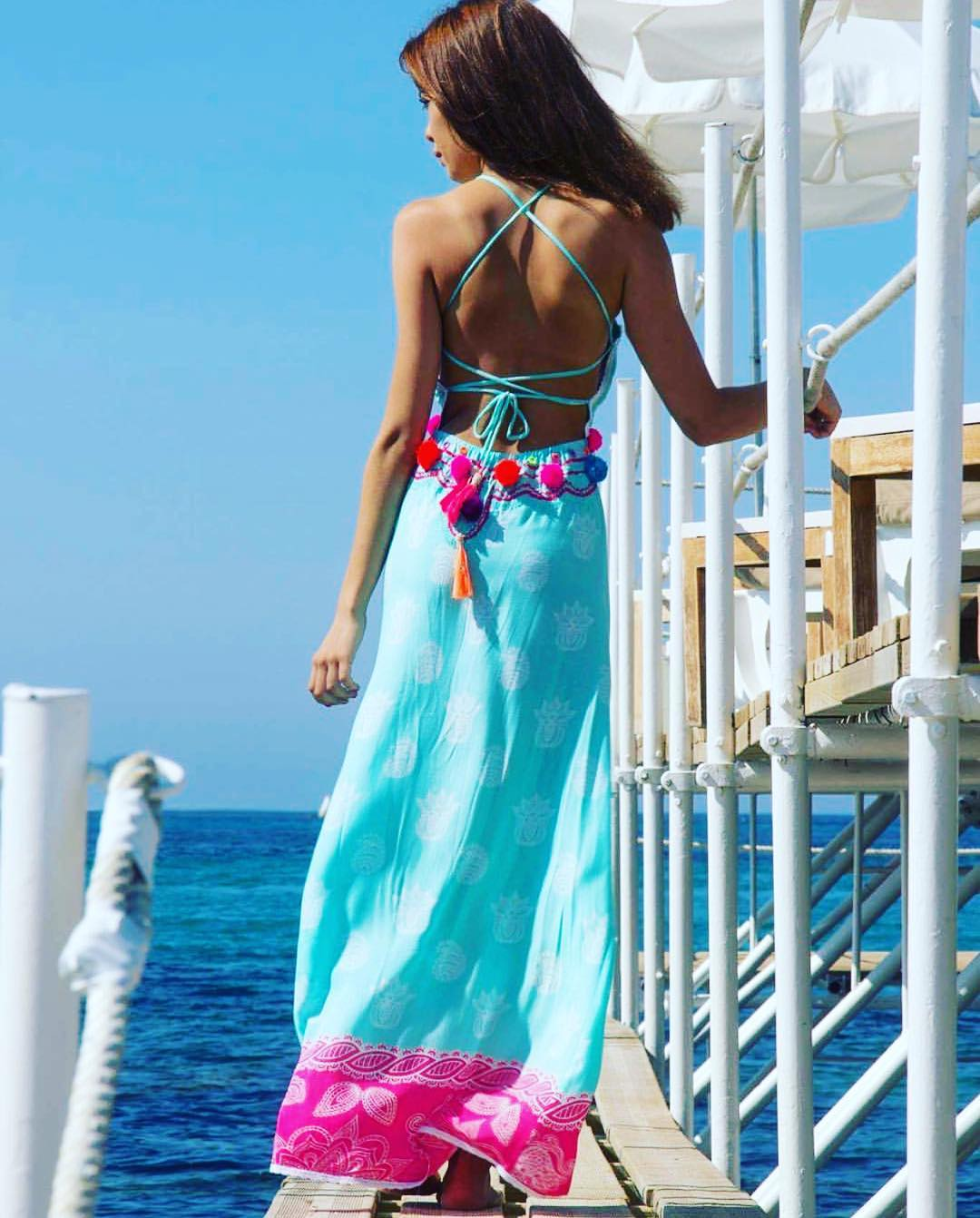 Turquoise dress worn by the sea