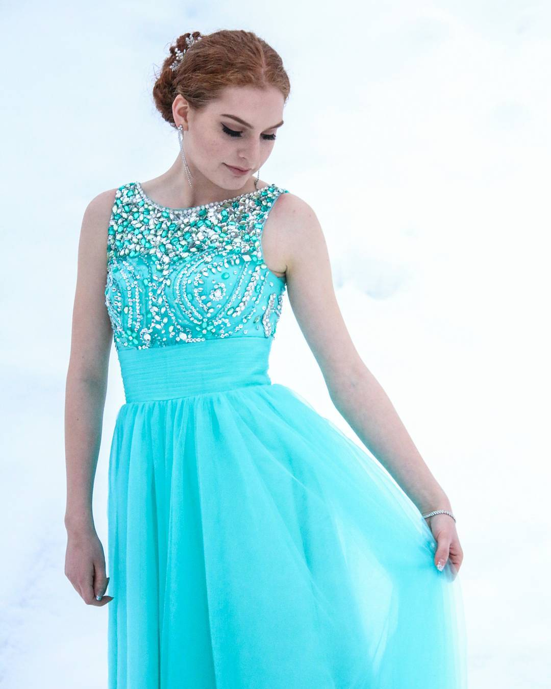 Turquoise bridesmaid dress adorned with stones
