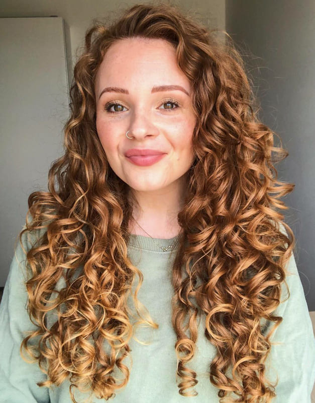 Blonde long strong curly hair