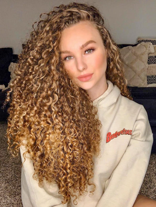Blonde volumed long curly hair