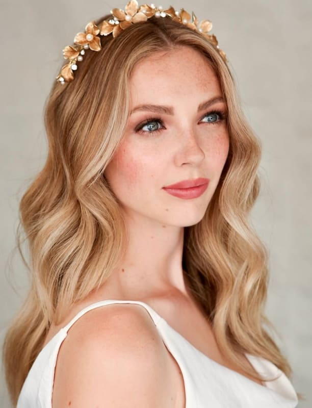 Long blonde ombre wedding hair with flowers