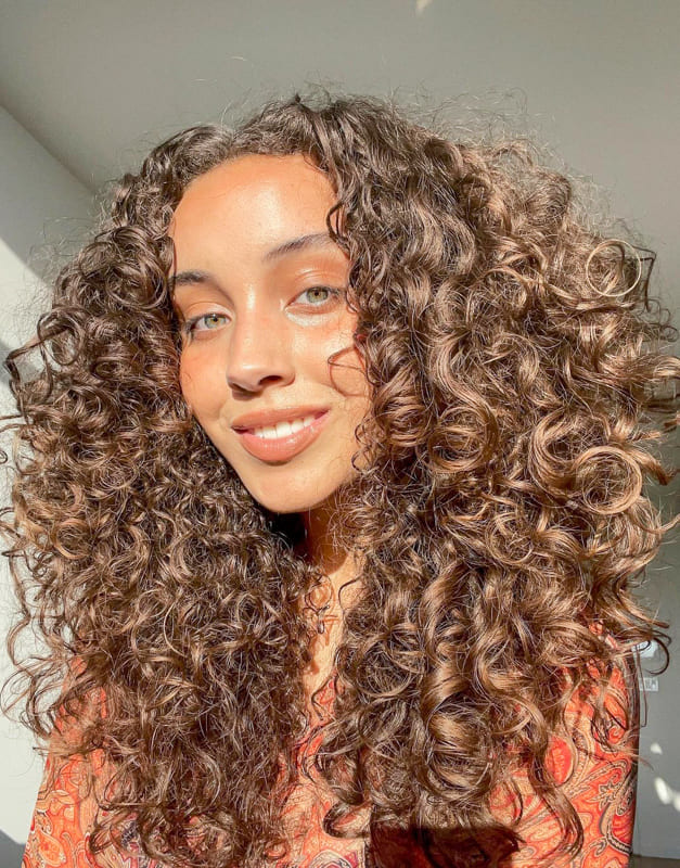 Long curly hairstyles for natural hair color