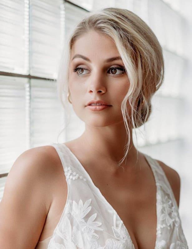 Long platinum blonde updo wedding hair