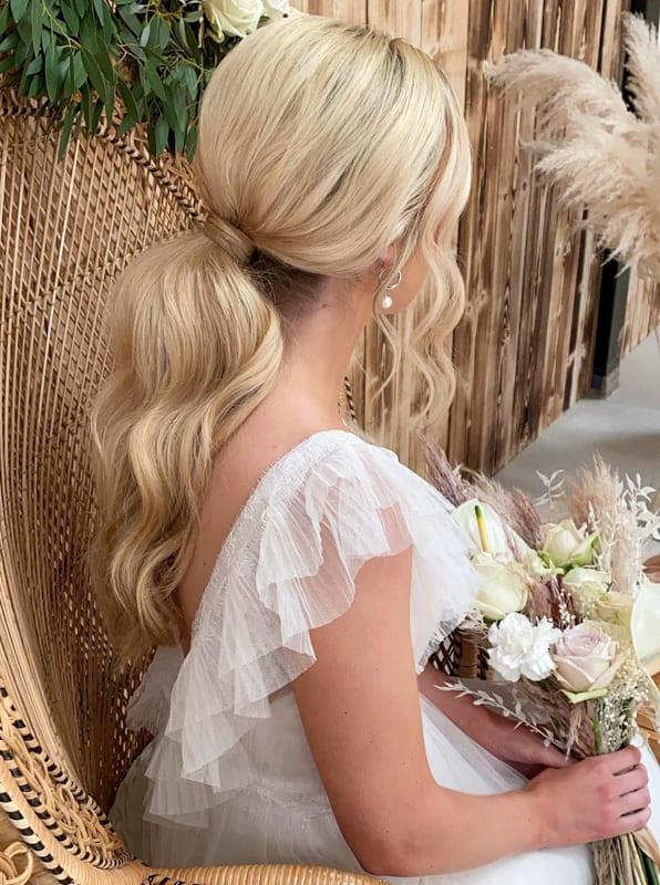 Long ponytail wavy wedding hair