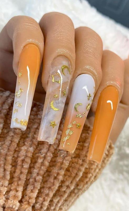 Orange glitter ombre nails