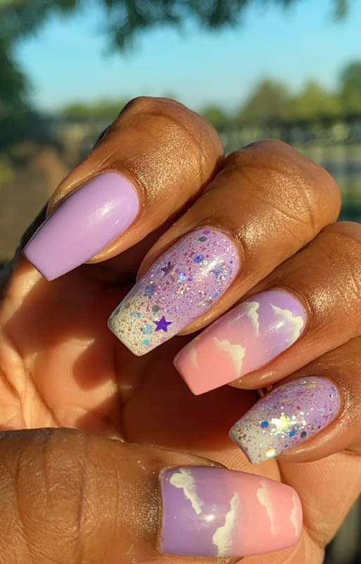 Purple with stars ombre nails