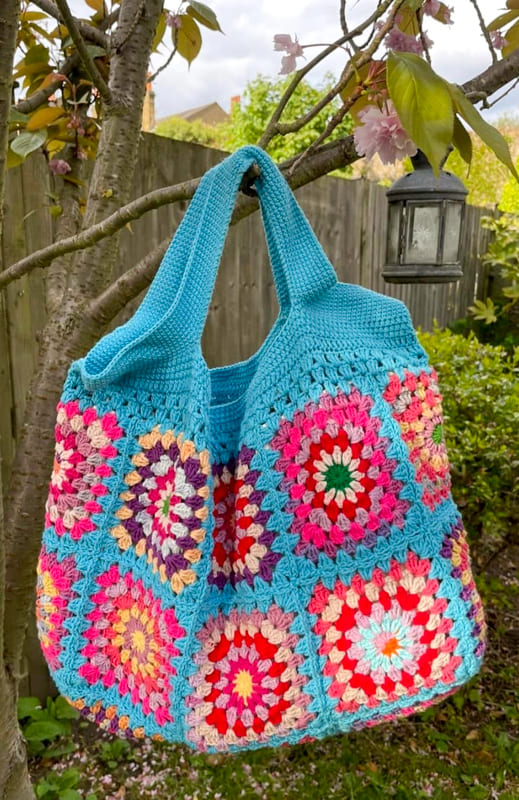 Blue and pink granny square crochet bag
