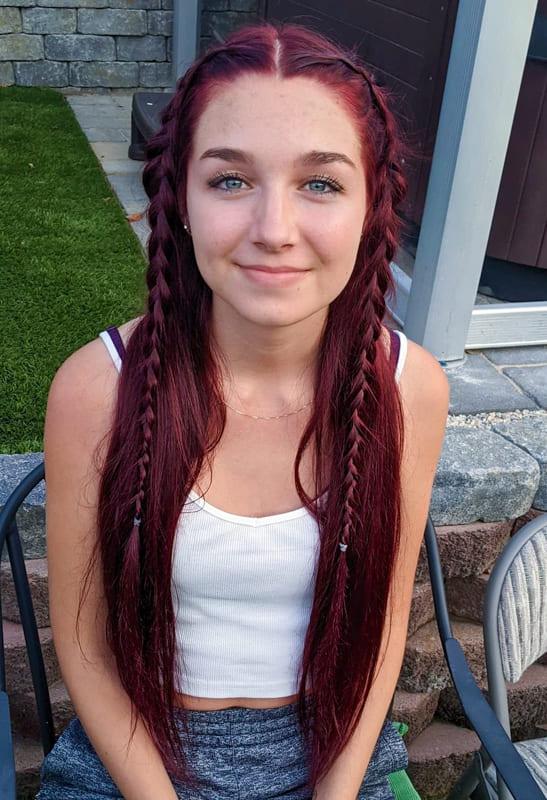 Long braided burgundy hair