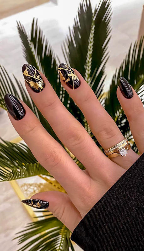Black and gold almond nails
