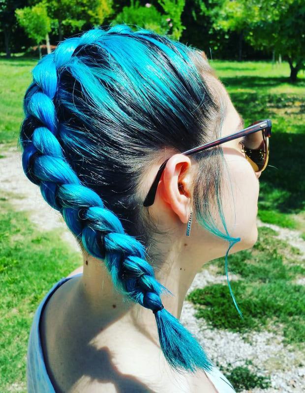 Blue teal braiding hair