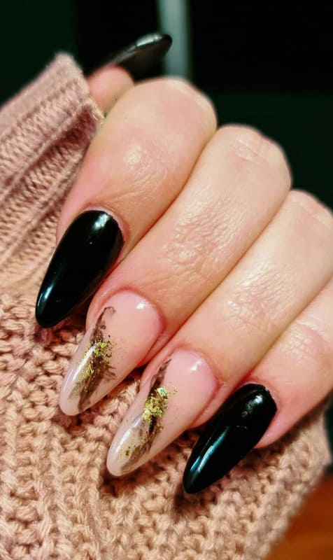 Gold and black almond acrylic nails