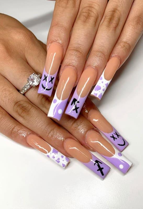 Long and emoji lavender nails