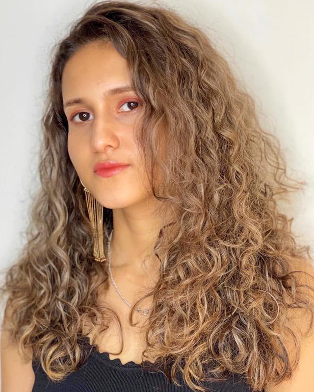 Long caramel curly hair highlights