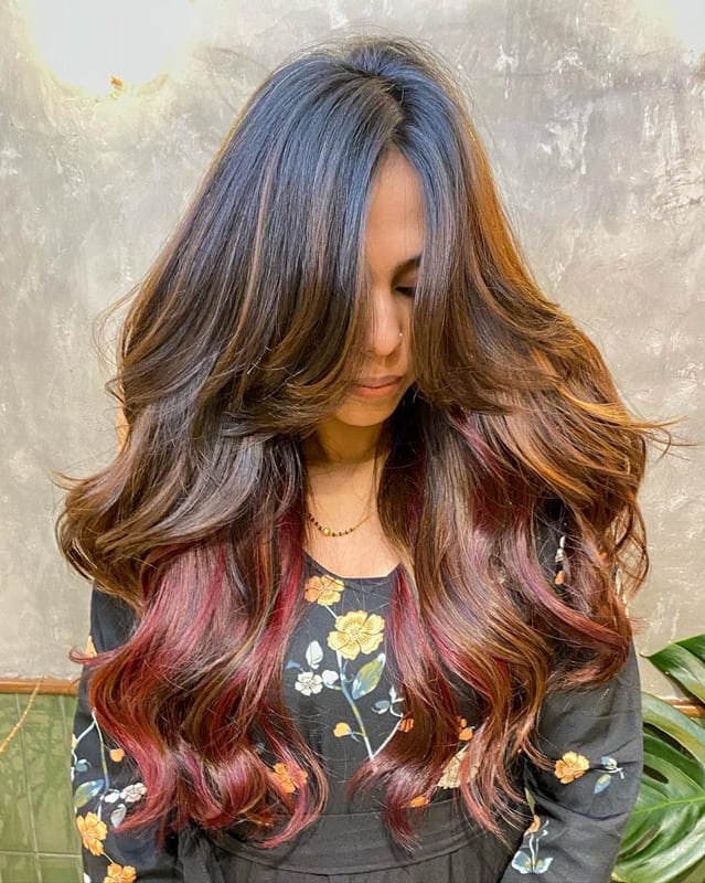 Long layered red hair with caramel