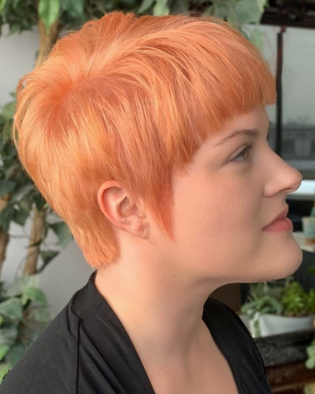 Short Pixie pastel orange hair