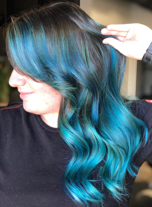 Wavy teal and brown hair